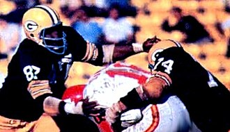 Len Dawson - Dawson (center) being tackled by the Green Bay Packers in Super Bowl I