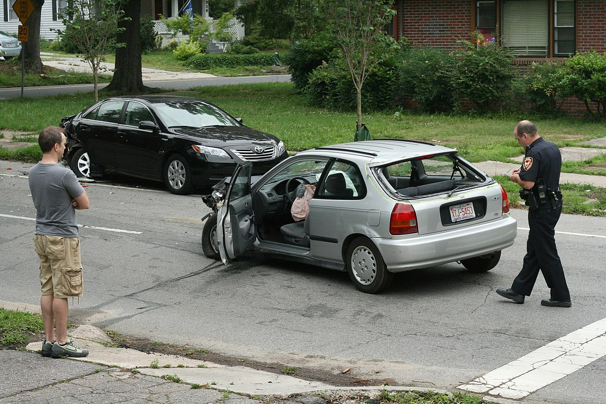 2010-05-30 Durham officer takes notes on wreck.jpg