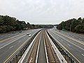 2018-10-26 11 32 08 View west along Virginia State Route 267 (Dulles Toll and Access Roads) and the Silver Line of the Washington Metro from the overpass for Virginia State Route 675 (Beulah Road) in Wolf Trap, Fairfax County, Virginia.jpg