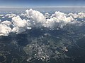 2019-07-19 13 07 05 Cumulus clouds developing over Front Royal in Warren County, Virginia, viewed from an airplane which recently took off from Washington Dulles International Airport.jpg