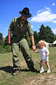 2nd Ukrainian Scout Jamboree 2009 - Rover Scout with kid.jpg