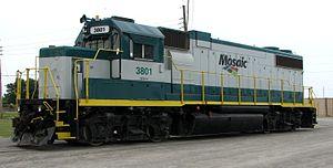 Agrock yard - An EMD GP38-2 diesel locomotive sits astride the tracks at the Agrock Rail switch yard.