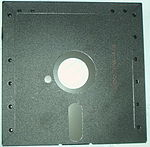 Front and back of a floppy with a write-protect tab