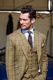 5a7452427bfca The model David Gandy wearing a bespoke suit by Henry Poole   Co (2014)