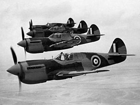 Four single-engined military monoplanes in flight