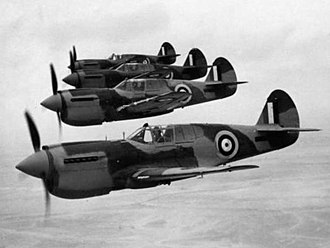 """No. 2 Operational Conversion Unit RAAF - Wing Commander Jeffrey (front) leading a flight of P-40 Kittyhawk fighters, including one flown by Squadron Leader """"Bluey"""" Truscott (second from rear), at No. 2 OTU, Mildura, in June 1942"""