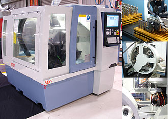 Tool and cutter grinder - A modern CNC tool grinder with automatic wheel pack exchanger and tool loading capabilities.