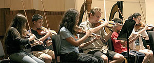 American Society of Composers, Authors and Publishers - ASCAP and Manhattan School of Music summer campers participate in daily symphonic band rehearsals. Since 1999, the two institutions have partnered with to offer a free music camp for students who attend New York City's public schools.
