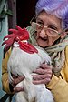 A 95 year old woman with her pet rooster, Havana, Cuba.jpg