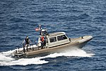 A U.S. Navy rigid-hull inflatable boat attached to the amphibious assault ship USS Bonhomme Richard (LHD 6) propels through the East China Sea March 11, 2014 140311-N-LM312-055.jpg