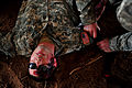 A U.S. Soldier with simulated wounds is treated by an Army medic during a medical exercise for Austere Challenge 2012 in Beit Ezra, Israel 121022-F-QW942-055.jpg