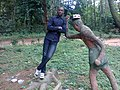 A boy close to a statue in a zoo in Nigeria.jpg