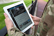 A serviceman accesses social media channels using an iPad, outside MOD Main Building in London MOD 45156044.jpg