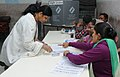A woman voter being registered her name to cast her vote, at a polling booth, during the 2nd phase of Gujarat Assembly Election, in Gandhinagar, Gujarat on December 14, 2017.jpg