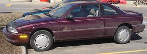 Oldsmobile Achieva - 1993 Oldsmobile Achieva S coupe (aftermarket hubcaps)