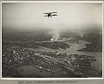 Aerial view of Sydney and the Harbour Bridge on the day of the official opening celebrations of the Sydney Harbour Bridge, 19 March, 1932 (6174054108).jpg