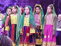 Afghanistan, March 2002 - Afghan girls sing at a celebration of International Women's Day, March 8. The ceremony took place at the Ministry of Women's Affairs, which USAID helped rehabilitate.