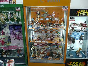 Anime and manga fandom - Display cases featuring typical Japanese anime and manga figurines in Akihabara