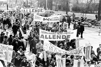 Foreign electoral intervention - Chilean workers marching in support of Allende in 1964.