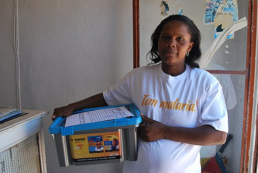An Angolan women holds a box of Coartem, an anti-malarial drug