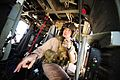 An aircrew member performs a pre-flight checklist over the desert during exercise Angel Thunder.jpg