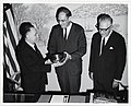 An unidentified man is presented with a ceremonial bowl by Deputy Mayor Henry Scagnoli with City Clerk Walter J. Malloy (12306419406).jpg