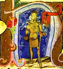 A crowned man holding a flag in his left hand