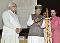 Arjun Ram Meghwal lighting the lamp at the release of a book 'Marching with a Billion Analysing Narendra Modi's Government at Midterm' written by Shri Uday Mahurkar, at IMT Manesar, Gurugram, Haryana.jpg