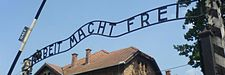 Auschwitz entrance (Wikivoyage main page banner).JPG
