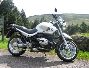 Side view of a silver BMW R1150R on the road side