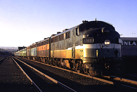 "A Burlington Northern EMD F3 leads the North Coast Hiawatha into Yakima, Washington, in July 1971, an example of early Amtrak ""rainbow"" consists, made up of equipment still painted in the colors of various freight carriers BN 9762 in Yakima Aug 71 NthCstHiRP.jpg"
