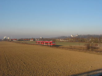 Neu-Ulm–Kempten railway - Regionalbahn service (class 650) south of  Illertissen, Martinskirche and Vöhlinschloss behind