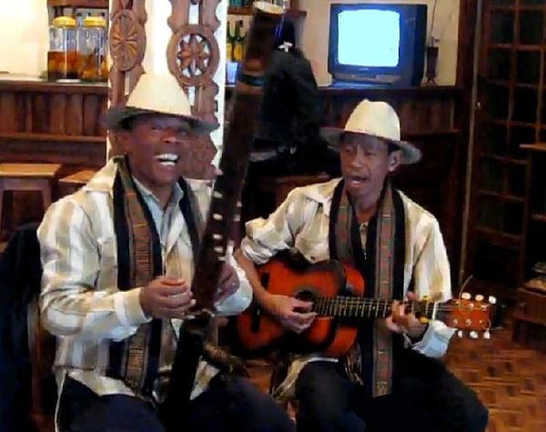 Malagasy musicians playing valiha and acoustic guitar Bagasy musicians madagascar valiha guitar.jpg