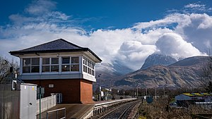Banavie railway station - The platform at Banavie with Ben Nevis's Hilltop covered in cloud and snow.