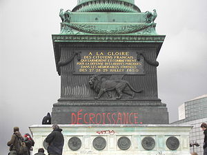 Degrowth - Pro-degrowth graffiti on the July Column in the Place de la Bastille in Paris during a protest against the First Employment Contract, March 28, 2006