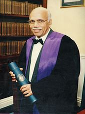 Image of man with black gown.