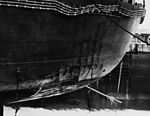 Bomb damage to stern of USS Enterprise (CV-6) after Battle of Eastern Solomons 1942 (NH 83992).jpg