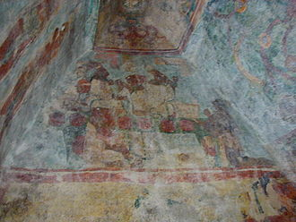 Bonampak - Upper register of the east wall in Room 3 featuring Bonampak noble women engaged in ritual bloodletting. Immediately above, in the vault, is a supernatural entity spewing blood.