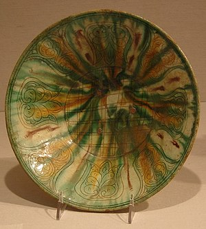 Alid dynasties of northern Iran - Alid-era art: Bowl with white slip, incised design, colored, and glazed. Excavated at Sabz Pushan,  Nishapur, Iran. 9th-early 10th century. New York Metropolitan Museum of Art.