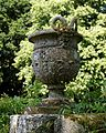 Bridge pan satyr urn in Pleasure Grounds, Parham House, West Sussex, England.jpg