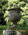 Bridge pan satyr urn in Pleasure Grounds, Parham House, West Sussex, England.jpg