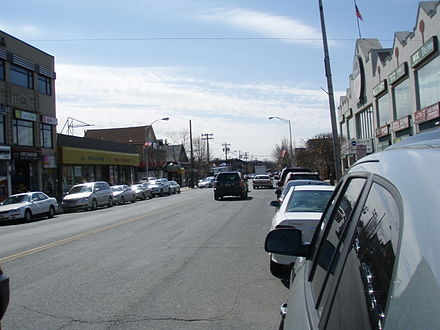 Bergen County is home to all of the nation's top ten municipalities by percentage of Korean population, led by Palisades Park (above), a borough where Koreans comprise the majority (52%) of the population and retail signs in Hangul (hangeul) are ubiquitous. Broad Avenue Palisades Park.jpg