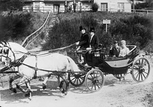 Sociable (carriage) - King George V and Queen Mary riding in the 'Balmoral' Sociable, July 1930.