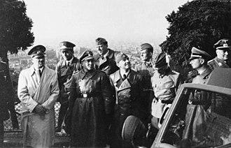 Martin Bormann - Bormann (directly to Hitler's left) in Paris. June 1940