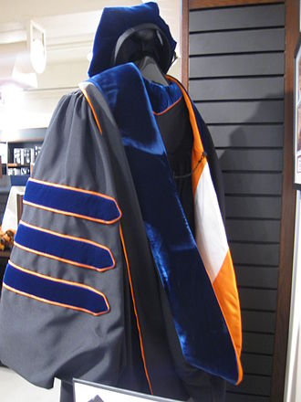 Academic dress in the United States - The doctoral hood of the California Institute of Technology. Note the blue velvet trim indicating philosophy; for degrees other than the Ph.D., the trim's color corresponds to the subject of the degree being awarded. The interior lining shows the school colors, in this case orange and white.