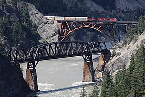 Fraser Canyon - Cisco Bridges - CPR bridge (black) in foreground, CNR bridge (orange arch) in background (with CPR train on it). Photo facing upriver.