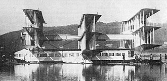 Caproni Ca.60 - The Caproni Ca.60 on Lake Maggiore. This picture, taken in 1921, shows the three wing sets mounted on top of the hull and the booms that connected them, as well as the panoramic cabin windows.