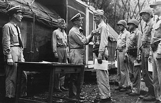 Evans Carlson - LtCol Carlson is decorated by Adm Chester W. Nimitz, on 30 September 1942.