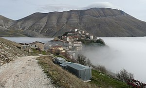 Castelluccio (Norcia) - View of Castelluccio from West. In the background is the Monte Vettore (2478m).