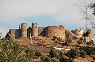 Castle of Evoramonte - The grey granite of the castle peeking from behind the medieval walls of the old city